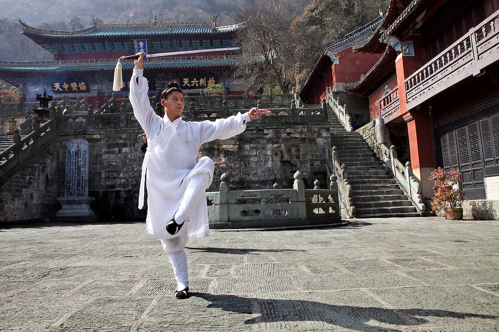 Asia, China, Hubei province. Master Guan teaching Tai Chi sword at the Purple Heaven Palace taoist temple on Wudang moutain (Wudang-san), a World Heritage mountain with many Taoist monasteries.