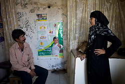 Vishwakarma Ramcharita arrives at a DOTS Center to tell the health care workers that although he has finished his treatment he still feels sick.  Yasmeen Shaikh, a health worker at the center, later took him to see a doctor at the local hospital.
