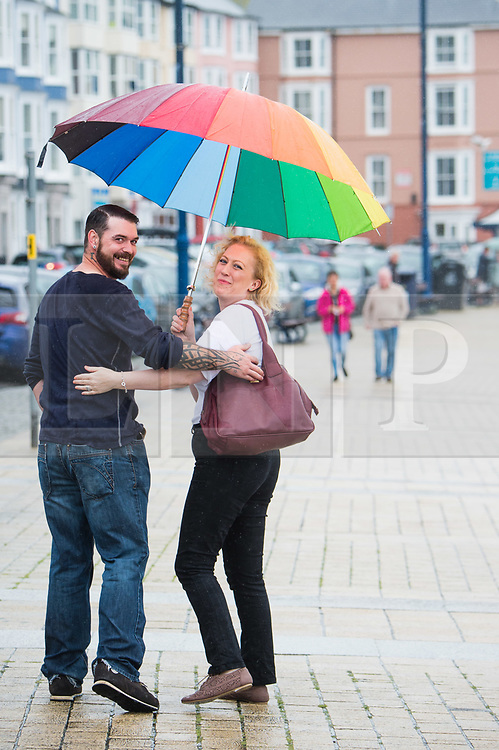 &copy; Licensed to London News Pictures. 01/08/2017. Aberystwyth, UK. Heavy rain lashes the promenade  in Aberystwyth, west Wales, on the first day of August 2017.  <br /> More wet and unsettled weather, caused by  the jet stream flowing further south than normal, is forecast for the rest of the summer. Photo credit: Keith Morris/LNP