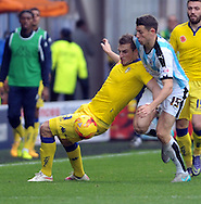 Murray Wallace of Huddersfield Town challanges Chris Wood of Leeds United for the ball during the Sky Bet Championship match at the John Smiths Stadium, Huddersfield<br /> Picture by Graham Crowther/Focus Images Ltd +44 7763 140036<br /> 07/11/2015