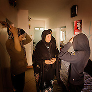 TUNISIA, SIDI BOUZID : Mannoubia, the mother of Mohammed Bouazizi, the 26-year-old graduate forced to sell fruit and vegetables to make a living who set himself on fire last month to protest against the seizure of his stand by police in Sidi Bouzid., with her daughter Basma. Copyright Christian Minelli.