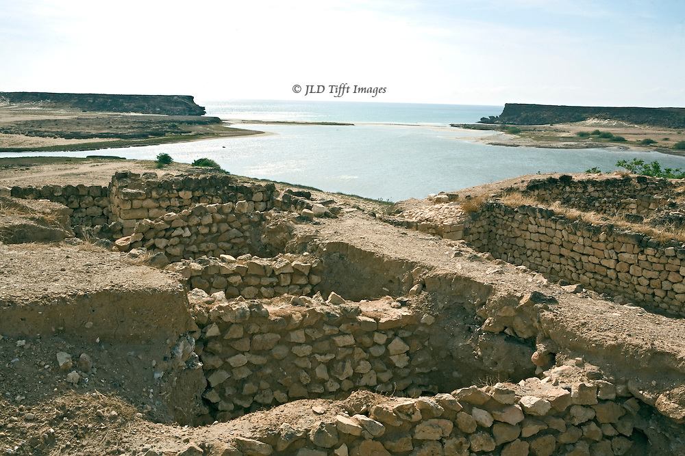 Oman, Sumhuram ruins, views over the remains toward the Indian Ocean and the ancient harbor.  View over the remaining wall stumps of the harbor warehouses.