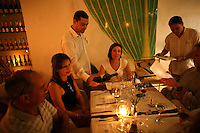 Wine is served for diners at 8-18, a popular restaurant in Cartagena's old city, on Thursday, August 23, 2008. (Photo/Scott Dalton)