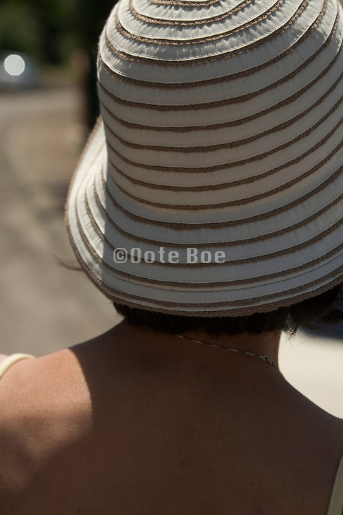 close up of woman with hat seen from behind