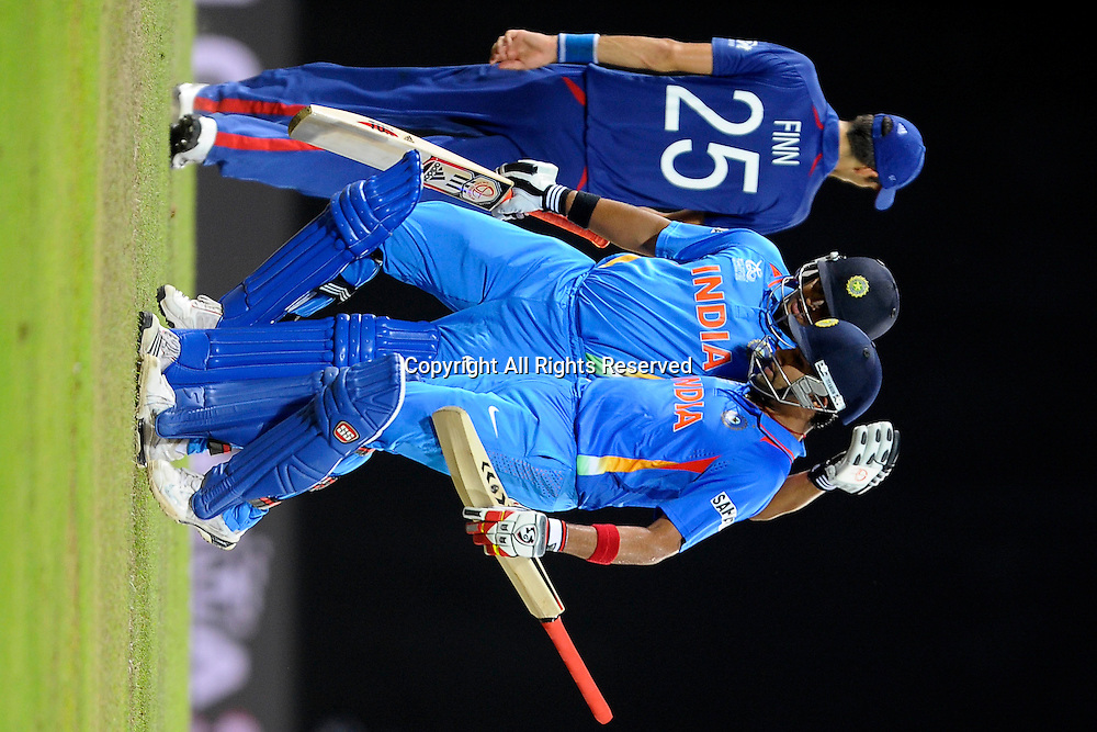 23.09.2012. Colombo, Sri Lanka. T20 World Cup England versus India held in Colombo Sri Lanka on the 23rd of September 2012 India's Suresh Raina (l) and Rohit Sharma at the end of the indian innings