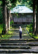 A man prays in front of the main hall inside the grounds of Hakusan Heisenji in Katsuyama, Fukui Prefecture, Japan on Oct. 4, 2016.  ROB GILHOOLY
