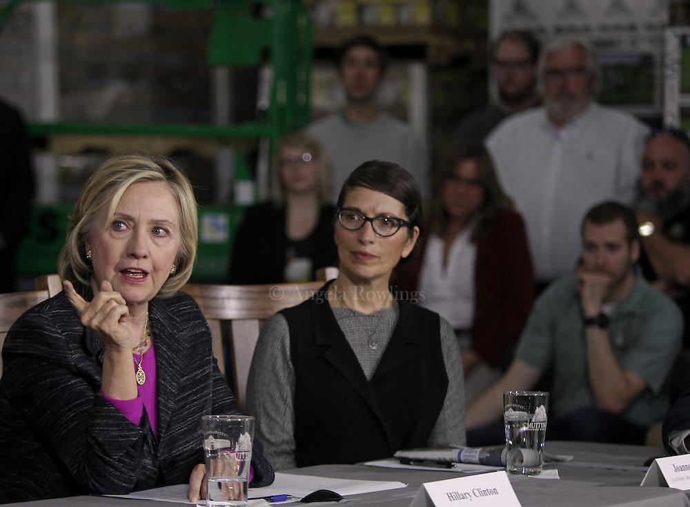 (Hampton, NH - 5/22/15) Former Secretary of State and presidential candidate Hillary Clinton speaks during a roundtable discussion with small business owners at Smuttynose Brewery, Friday, May 22, 2015. Smuttynose Brewing Company Co-owner Joanne Francis listens at center. Staff photo by Angela Rowlings.