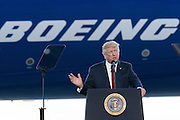 U.S. President Donald Trump smiles as he addresses employees at the debut of the new Boeing 787-10 Dreamliner aircraft at the Boeing factory February 17, 2016 in North Charleston, SC. The visit comes two days after workers at the South Carolina plant voted to reject union representation in a state where Trump won handily.