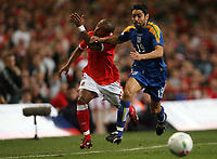 Photo: Rich Eaton.<br /> <br /> Wales v Cyprus. UEFA European Championships 2008 Qualifying. 11/10/2006. Robert Earnshaw of Wales is fouled by Alexandros Garpozis of Cyprus