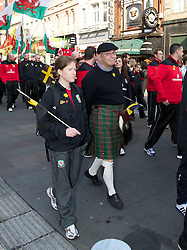 CARDIFF, WALES - Thursday, March 1, 2012: Members of the Football Association of Wales take part in the 10th St. David's Day Parade through the streets of Cardiff. Media Officer Ceri Stennett and performance analyst Esther Laugharne. (Pic by David Rawcliffe/Propaganda)