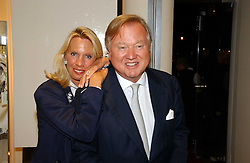 SIR ANTHONY & LADY BAMFORD at a party to celebrate the launch of the Crine Gilson store at 12 Lowndes Street, London SW1 on 10th October 2006.<br /><br />NON EXCLUSIVE - WORLD RIGHTS