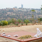 Yellow roses and other flowers sit atop on of the mass graves at the Kigali Memorial Centre in downtown Kigali, Rwanda.