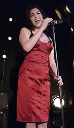 Singer Amy Winehouse performing during the BRIT Awards 2004 Nominations launch, held at the Park Lane Hotel, central London. The major annual awards, highlighting the achievements of the UK record industry, will be held on February 17 at Earls Court 2 in London.