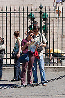 tourists with map around Église de la Madeleine Paris France in May 2008