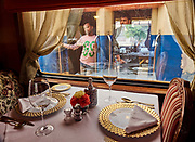 India, Uttar Pradesh. Vyasnagar station. Maharajas' Express luxury train. Rang Mahal (Color Palace) dining car waiting for departure next to a regular express train.
