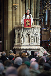 © Licensed to London News Pictures . 10/11/2013 . Bury , UK . The Rector of Bury , JOHN FINDON , leads the memorial service inside the church . Remembrance Sunday service at Bury Parish Church , Greater Manchester today (Sunday 10th November 2013) . Photo credit : Joel Goodman/LNP