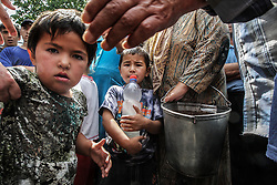 Children get water in a refugees camp on the border with Uzbekistan 7km from Osh, Kyrgyzstan, 15 June 2010. According to media reports 176 people were killed and 1700 wounded during the ethnic clashes in Kyrgyzstan during past days.