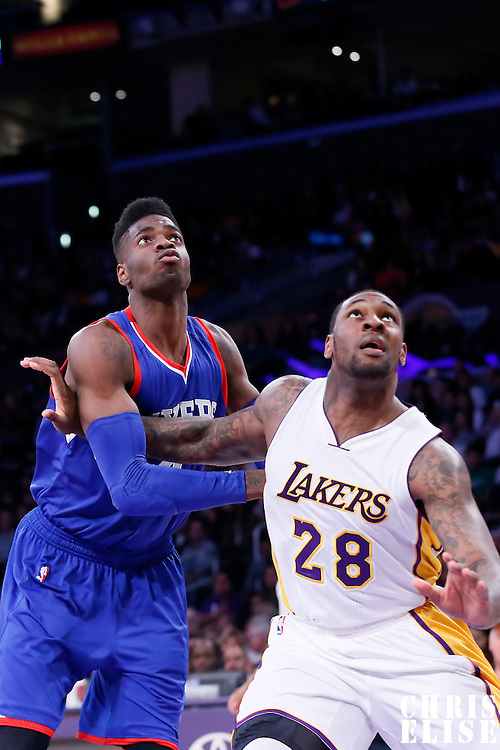 22 March 2015: Philadelphia 76ers center Nerlens Noel (4) vies for the rebound with Los Angeles Lakers forward Tarik Black (28) during the Los Angeles Lakers 101-87 victory over the Washington Wizards, at the Staples Center, Los Angeles, California, USA.