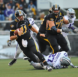 Nov 13, 2010; Columbia, MO, USA; Missouri Tigers quarterback Blaine Gabbert (11) runs for yardage in the second half against the Kansas State Wildcats at Memorial Stadium. Missouri won 38-28.  Mandatory Credit: Denny Medley-US PRESSWIRE