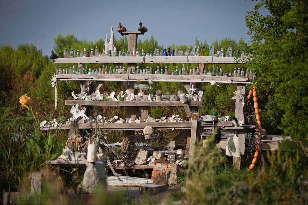 Edison Darder's scupture in his backyard made up of objects he has found along the shore of isle de Jean Charles.