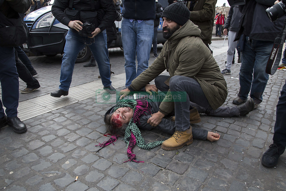 February 5, 2018 - Rome, Rome, Italy - A protester seen injured and fallen to the floor after clashing with the police..Hundred of demonstrators clashed with police near the Vatican during the Turkish president's visit to Rome, as protesters denounced Recep Tayyip Erdogan's presence amid Ankara's anti-Kurdish military campaign in Syria, at least one person injured. (Credit Image: © Danilo Campailla/SOPA via ZUMA Wire)