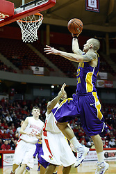 12 January 2011: Marc Sonnen right hands a left side lay up going past Jackie Carmichael during an NCAA Missouri Valley Conference men's basketball game between the Northern Iowa Panthers and the Illinois State Redbirds at Redbird Arena in Normal Illinois.