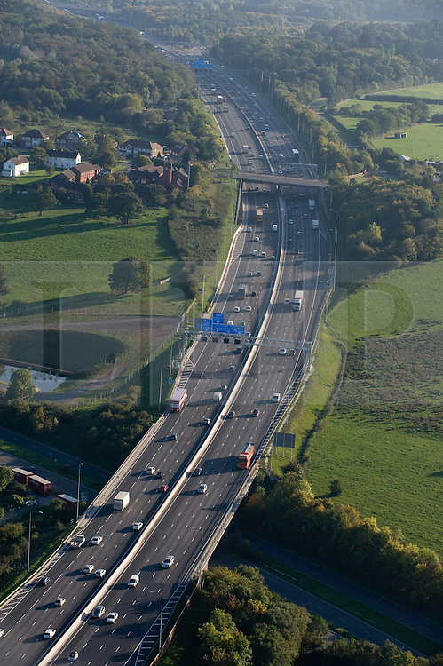© under license to London News Pictures.  File picture dated 11/10/2010. the M25 motorway near junction 16 with the M40 in Buckinghamshire. The M25 will tomorrow (29/10/2011) be 25 years old. 117-mile London Orbital motorway was opened by then Prime Minister Margaret Thatcher on October 29, 1986. Photo credit: London News Pictures.