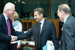 Hans-Gert Pottering, president of the European Parliament, left, greats Nicolas Sarkozy, France's president, center, as Javier Solana, the EU's foreign policy chief, looks on, during the European Summit, Thursday, June 18, in Brussels, Belgium. (Photo © Jock Fistick)