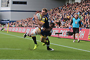 Worcester Warriors Chris Pennell  Full back (15) tackled by Bath Semesa Rokoduguni  Wing (14) first half during the Aviva Premiership match between Worcester Warriors and Bath Rugby at Sixways Stadium, Worcester, United Kingdom on 15 April 2017. Photo by Gary Learmonth.