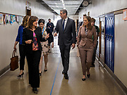 """08 APRIL 2019 - DES MOINES, IOWA: Rep. TIM RYAN (center) and his wife, ANDREA RYAN (right), walk through the halls with school administrators at Callanan Middle School. Ryan, a candidate for the Democratic ticket of the US presidency, visited Callanan Middle School in Des Moines to discuss education issues. Ryan declared his candidacy on the US television show """"The View"""" on April 4. Ryan, 45 years old, represents Ohio's 13th District, which includes Lordstown, where a large General Motors plant recently closed. He is the latest Democrat to announce his candidacy to be the Democratic nominee in the 2020 election. Iowa holds its presidential caucuses on Feb. 3, 2020.      PHOTO BY JACK KURTZ"""