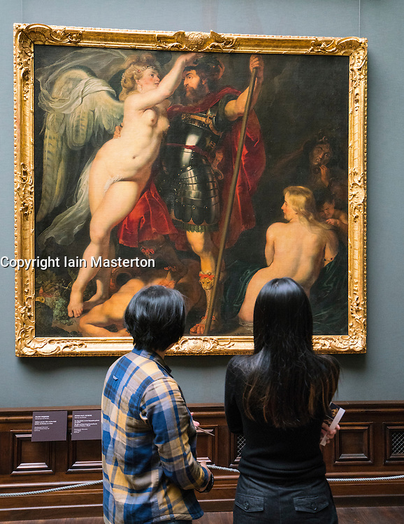 """Visitors looking at painting """" The Hero of Virtue being Crowned by the Goddess of Victory"""" by Peter Paul Rubens at Gemäldegalerie Alte Meister or Zwinger Museum in Dresden, Germany .Editorial Use Only."""