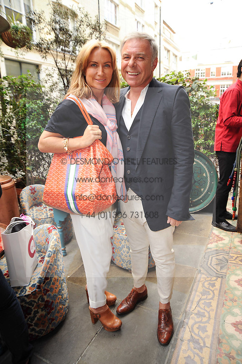 MEG MATTHEWS and PETER SIDELL at a party to celebrate the launch of Laura Mercier's perfume Ambre Pssion Elixir held at Momo's, 25-27 Heddon Street, London on 27th May 2010.
