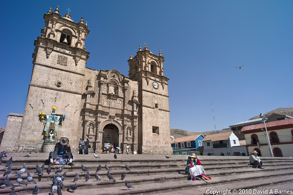 People on steps of Cathedral, Puno, Peru