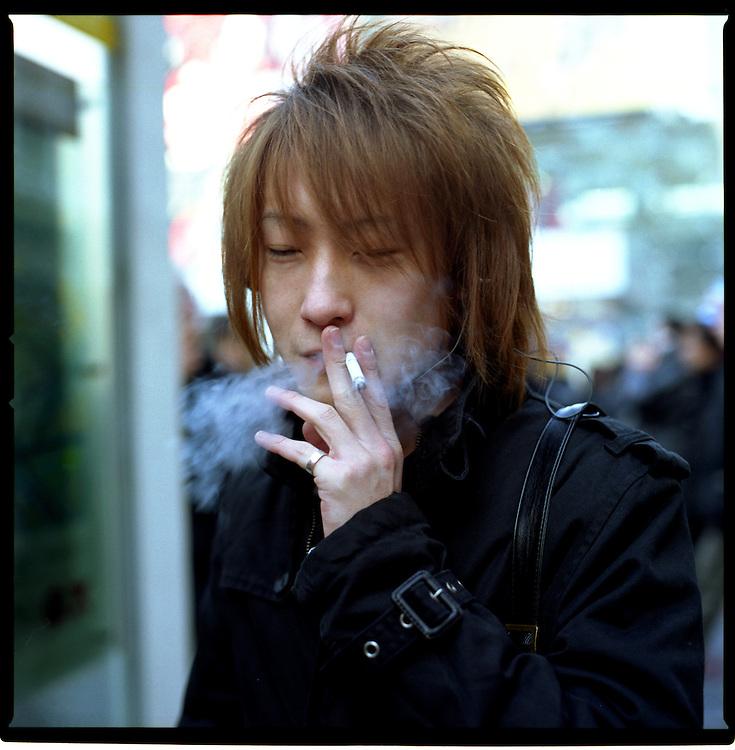 Gal-O boy smoking at Hachiko Square, Shibuya, Tokyo, Japan.