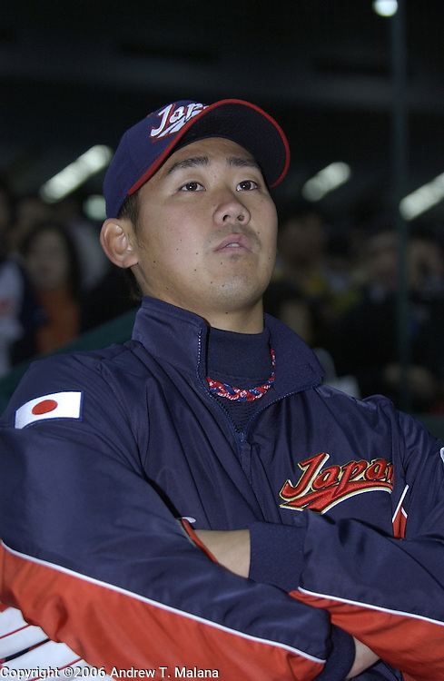 Team Japan starter Daisuke Matsuzaka listens to a reporter's question before the start of the game against Team Korea in the World Baseball Classic at Tokyo Dome, Tokyo, Japan.