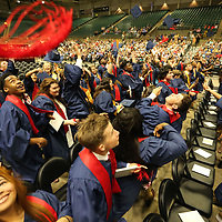 Nettleton High School seniors celebrate graduation as they toss their caps into the air Saturday morning at the BancorpSouth Arena in Tupelo.
