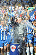 Wigan Manager Gary Caldwell lifts the league One trophy after his side get beat in the Sky Bet League 1 match between Wigan Athletic and Barnsley at the DW Stadium, Wigan, England on 8 May 2016. Photo by John Marfleet.