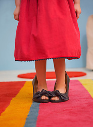 Young girl wearing woman shoes