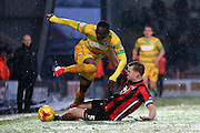 Morecambe Defender Adan Dugdale with a snow sliding challenge during the Sky Bet League 2 match between Morecambe and Yeovil Town at the Globe Arena, Morecambe, England on 16 January 2016. Photo by Pete Burns.