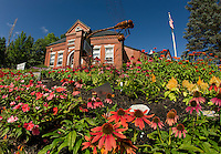 Beautiful gardens adorned with #7 Dragonfly of the Meredith Sculpture Walk on the front lawn of the Meredith Public Library.  (Karen Bobotas/for the Laconia Daily Sun)