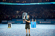 Andy Murray of Great Britain  holds up the ATP Trophy after his Final's match on  day eight of the Barclays ATP World Tour Finals at the O2 Arena, London, United Kingdom on 20 November 2016. Photo by Martin Cole.