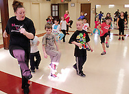 (from left) Teacher Andrea Nelson of the Miami Valley Dance Academy leads, as Miles Boston, 5; Alexander Zook, 6 and Garrett Napier, 7 watch and follow along during the first of six hip-hop dance classes at the Carnegie Center in Miamisburg , Saturday, January 28, 2012.