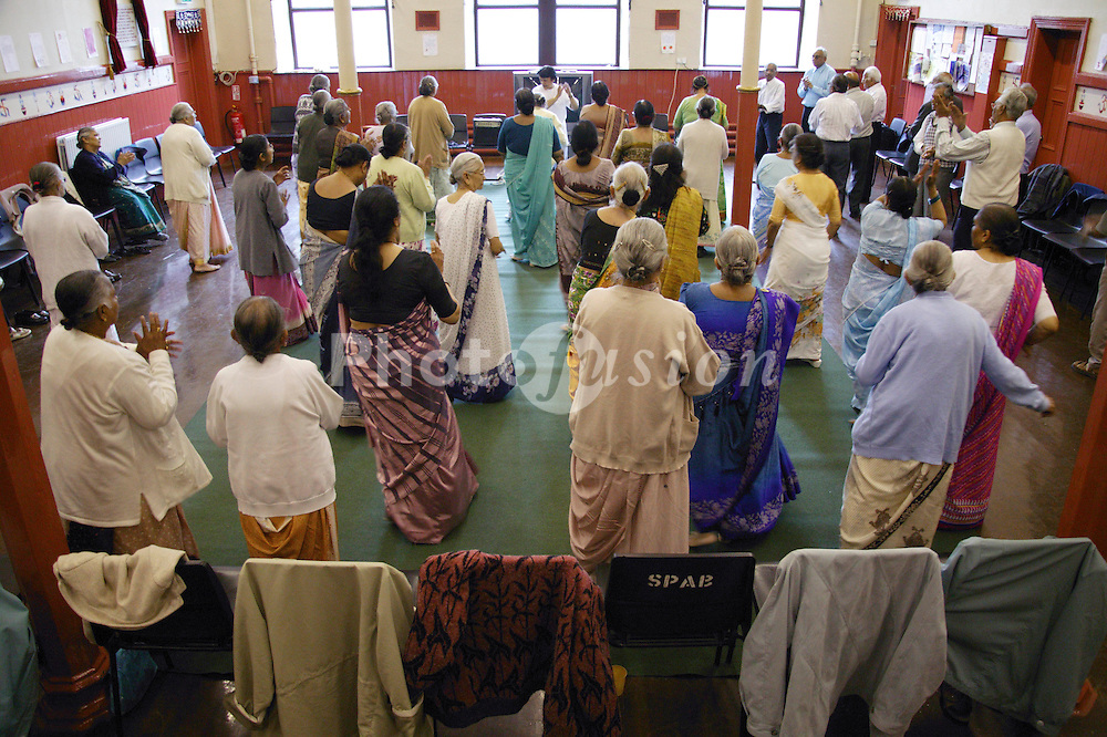 Group of elderly men and women taking part in exercise class,