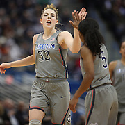 HARTFORD, CONNECTICUT- DECEMBER 19:  Katie Lou Samuelson #33 of the Connecticut Huskies high fives team mate Crystal Dangerfield #5 of the Connecticut Huskies after hitting a three point basket during the UConn Huskies Vs Ohio State Buckeyes, NCAA Women's Basketball game on December 19th, 2016 at the XL Center, Hartford, Connecticut (Photo by Tim Clayton/Corbis via Getty Images)