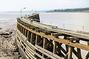 Wooden breakwater jetty at entrance from River Severn, to Sharpness docks, Gloucestershire, England, UK