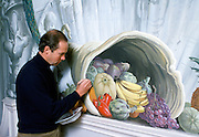 British artist Graham Rust painting a mural in the South Staircase Hall of Ragley Hall stately home of the 8th Marques of Hertford, UK