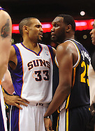 Feb. 15, 2011; Phoenix, AZ, USA; Phoenix Suns forward Grant Hill (33) and Utah Jazz center Al Jefferson (25) react on the court at the US Airways Center. The Suns defeated the Jazz 102-101. Mandatory Credit: Jennifer Stewart-US PRESSWIRE.