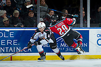 KELOWNA, CANADA - NOVEMBER 10: Nolan Foote #29 of the Kelowna Rockets gets tripped up by Alex Kannok Leipert #41 of the Vancouver Giants during third period on November 10, 2017 at Prospera Place in Kelowna, British Columbia, Canada.  (Photo by Marissa Baecker/Shoot the Breeze)  *** Local Caption ***