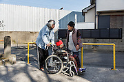 Kawasaki, November 21 2014 - Japanese artist Tatsumi ORIMOTO, 69, and his 97-year-old mother chatting with a neighbor at the park near their house .