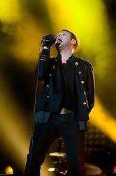 Tom Meighan Kasabian's vocalist on stage at the Sheffield Arena during the West Ryder Pauper Lunatic Asylum 23 November 2009